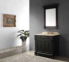 bathroom black wooden bathroom vanity with cream sink and top on