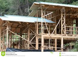 building of a wooden house on a slope stock image image 24951125