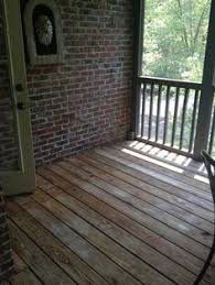 screened in porch enclosure with existing brick knee wall and