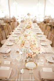 pale pink table cover gold beaded chargers bread plates crystal glasses and pale pink