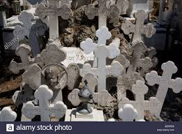 a grave in athens first cemetery with a a cluster of crosses