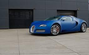 blue bugatti beautiful blue bugatti veyron super sport in grey walls pictures