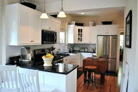 granite kitchen backsplash pictures of kitchens with white cabinets and black countertops