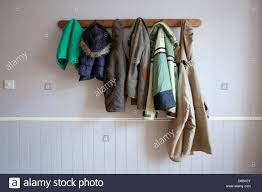 coats hanging on coat rack stock photo royalty free image