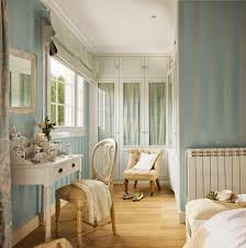 a cool blue dressing room with stripe wallpaper idea and rustic