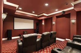 living room red wall theme and black leather seats on red carpet