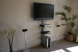 gray solid wood floating cabinet as tv stand under light brown