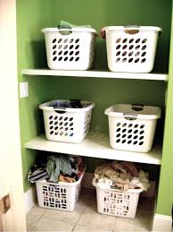 Laundry Room Storage Cabinets Ideas - small and narrow laundry room storage with custom diy wood wall