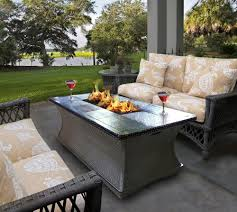 convenient propane outdoor fireplace in summer evenings