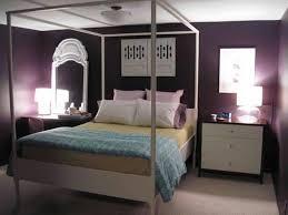 bedroom black platform bed white dressers white pillow white