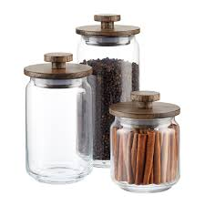 clear glass canisters for kitchen artisan glass canisters with walnut lids the container store