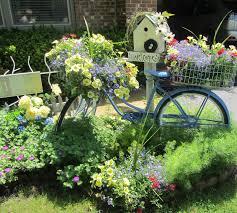 repurpose old bike as flower garden my bike flowers are starting