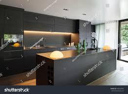 black kitchen furniture modern kitchen black furniture wooden floor stock photo 448253599