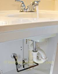 how to replace a pop up sink drain pivot rod and p trap