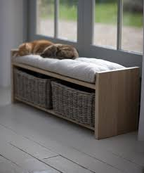 artistic storage bench seat for hallway below fat orange tabby cat