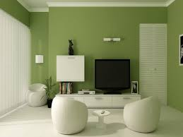living room green accent wall also white ceramic tile flooring