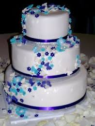 elegant white wedding cake with crystal ribbon accented with teal