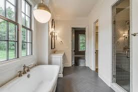 Dark Wood Like Tiled Bathroom Floor Transitional Bathroom - White cabinets dark floor bathroom