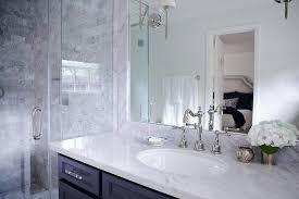 Dual Illuminated Vanity Mirrors Bathroom With Navy Washstand Transitional Bathroom