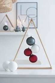 wooden frame tree with matte ornaments inside holidays