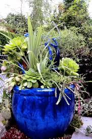blue container garden with glass ornaments from the garden of