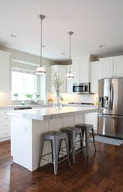 white l shaped kitchen with island this is more traditional than i like but i like how light it is