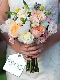 wedding flowers cost soft pastel bouquet of white pink and orange flowers cost
