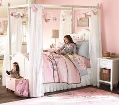 Pink Canopy Bed White Wooden Girls Canopy Bed Decorated With Sheer Curtain And