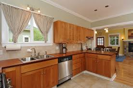 white marble kitchen counter top wooden varnish cabinet wood