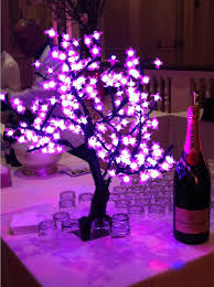 in led light up pink cherry blossom trees make lovely table