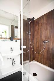 badezimmer laminat glas laminat dusche mit rostoptik als duschrückwand