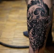 picture of black and white skull on a leg
