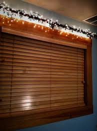 How To Hang Christmas Lights On House by Hang Christmas Lights Over Window With Curtain Rod Home Sweet