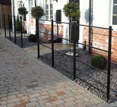 Front Yard Metal Fences - great small garden with fresh planters and great gravels feat dark