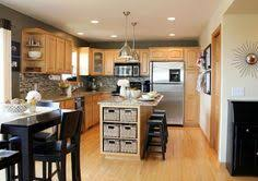 maple cabinets with dark counters mom and dads kitchen maple cabinets paint color for walls kitchen w maple cabinets