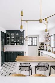 best 25 black white kitchens ideas on pinterest marble kitchen our newest obsession concrete flooring with bold patterns wit and delight home tour