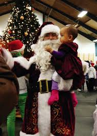 santa caught in the act gifts greenlandic children during