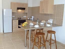 minimalist kitchen island plain wooden plank wall sleek white gas