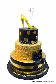 cake in black with gold sequins and golden shoe