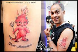 baby red devil tattoo design on arm jpg 800 533 osoby pinterest