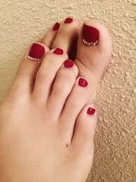 deep red toes with little rhinestones on the big toes fingers