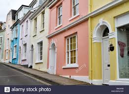 pretty houses steep hill with colorful row houses and parked cars stock photo