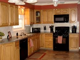 kitchen with oak cabinets with black appliances exitallergy com