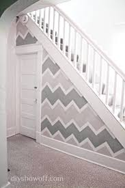 painting funky entryway wall design using frogtape chevron stencil