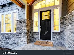 front covered porch design boasts stone stock photo 564058417
