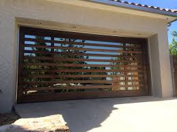 modern garage doors in an astonishing protection amaza design brilliant modern garage doors design with wooden and glass material combined with concrete wall design in