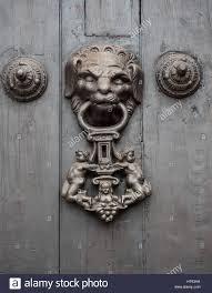 detail of a vintage metal decorative door knob on a wooden door