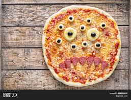 vintage halloween background halloween scary food monster zombie face pizza snack with