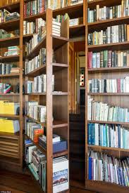 musical farmhouse designed with secret corridor behind a bookshelf