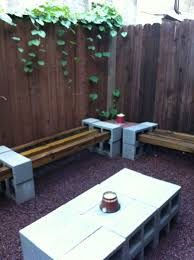rustic cinder block bench with wood fence and outdoor area and